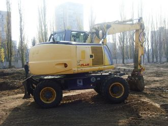 фото: Экскаватор New Holland MN Plus с гидромотолом